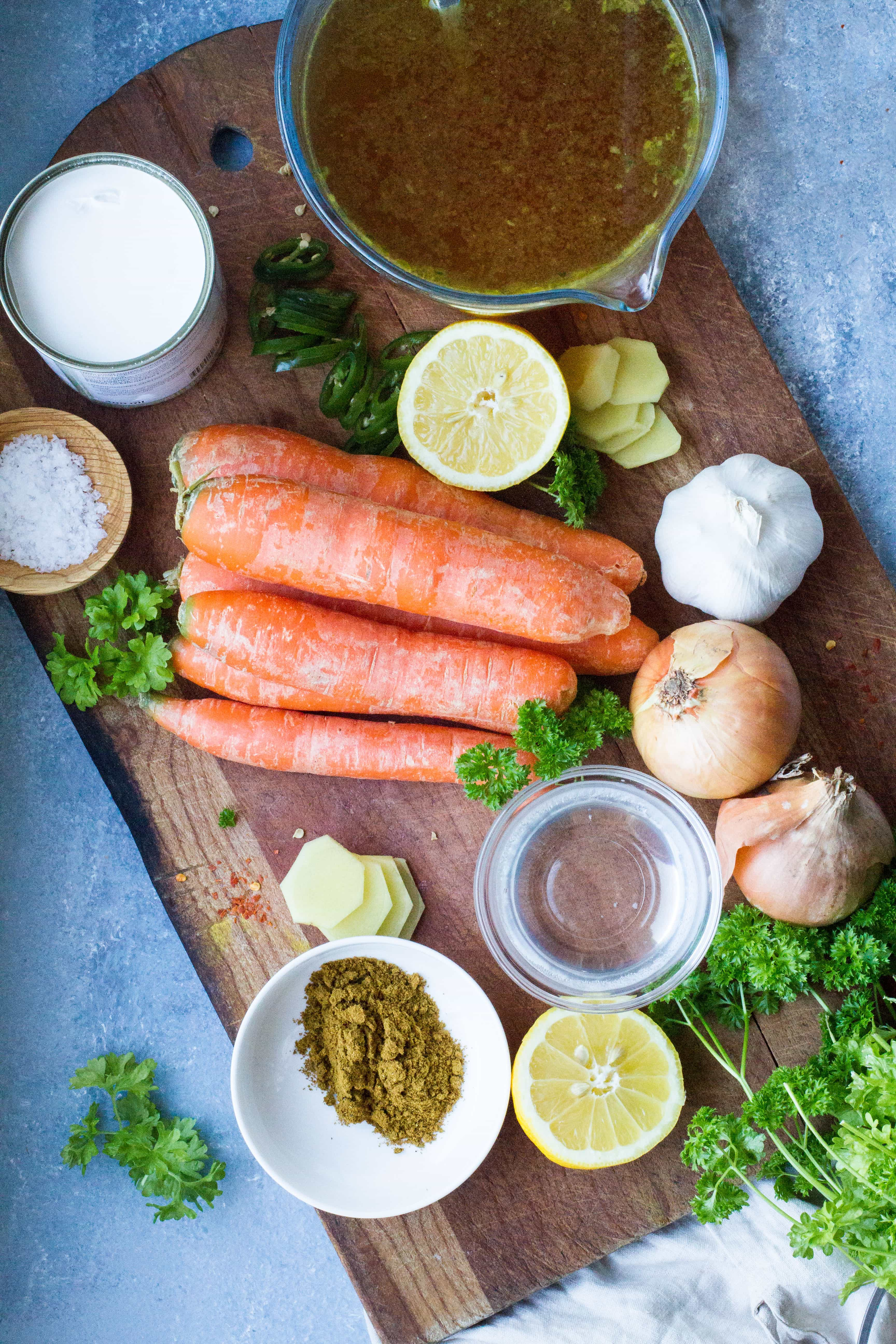 Ingredients to make curry coconut carrot soup.