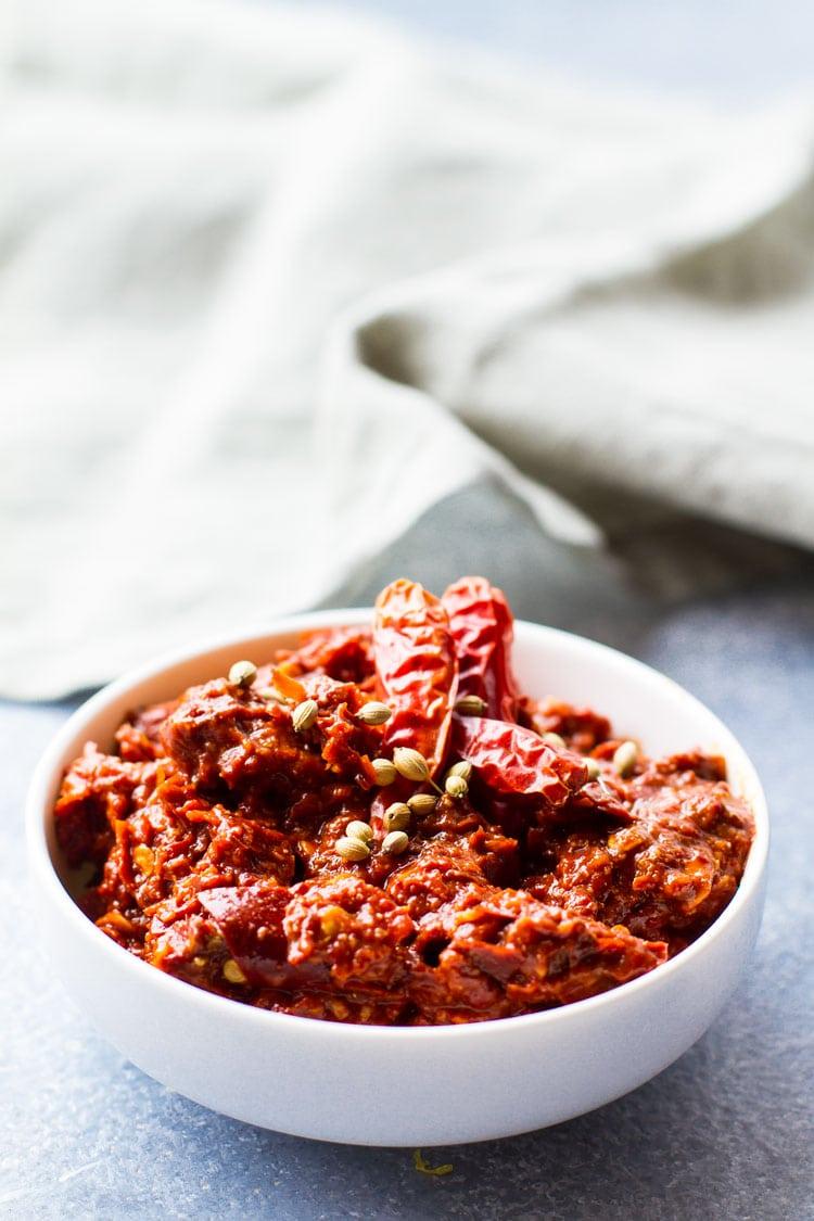 Harissa chili paste in a small white bowl.