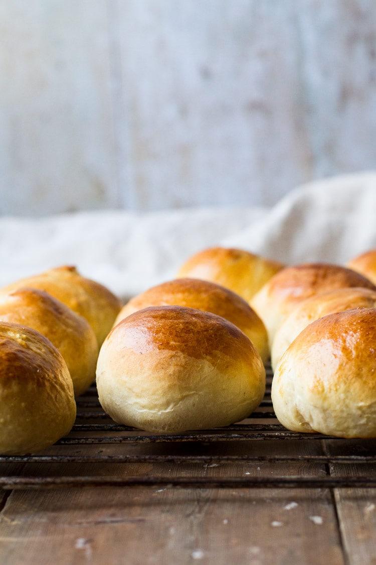 Closeup of sweet rolls on a cooling rack.