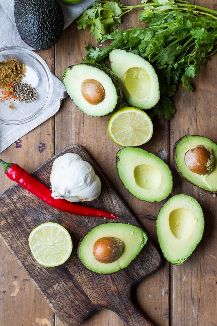 Ingredients to make this easy guacamole recipe. Flatlay.