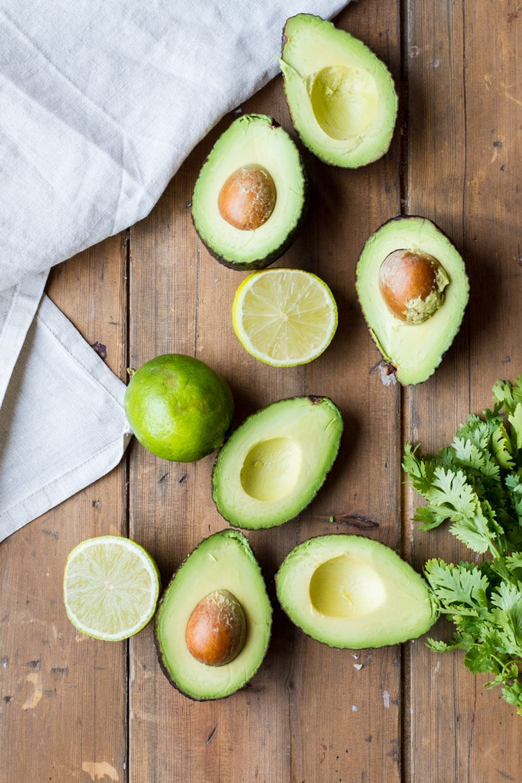 Opened avocados and lime for easy guacamole recipe.