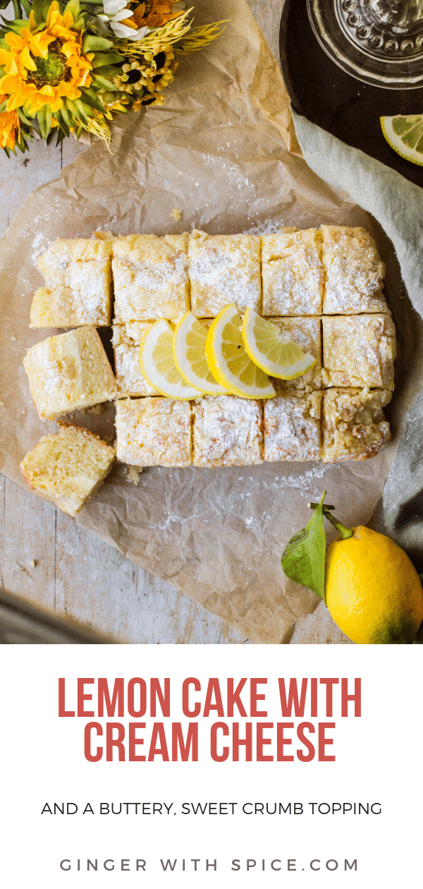 Lemon Cake with lemon slices and powdered sugar on top. Background is parchment paper and a green towel. Some yellow flowers and lemons in the corner. Pinterest pin.