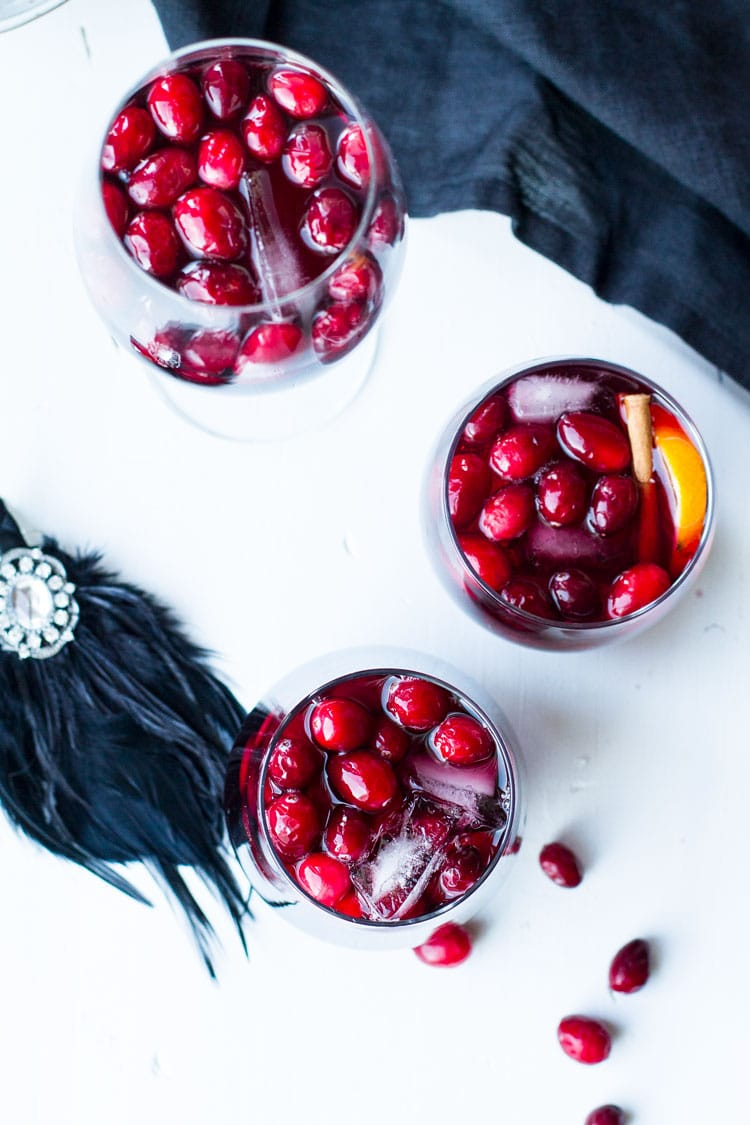 Three glasses filled with cranberries.