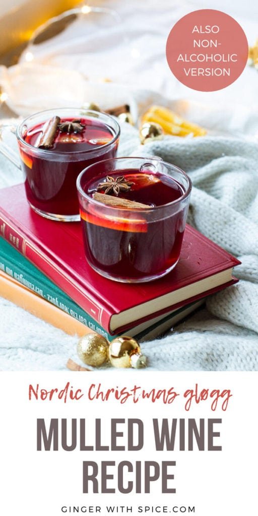 Glass mugs with mulled wine on a red book. Pinterest pin.