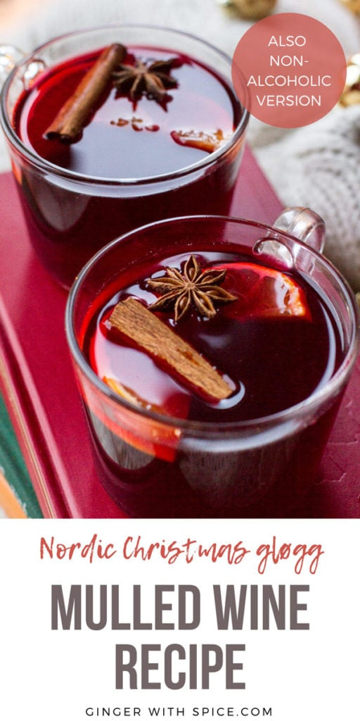 Two mugs with mulled wine garnished with cinnamon stick, star anise and clementine slice. Pinterest pin.