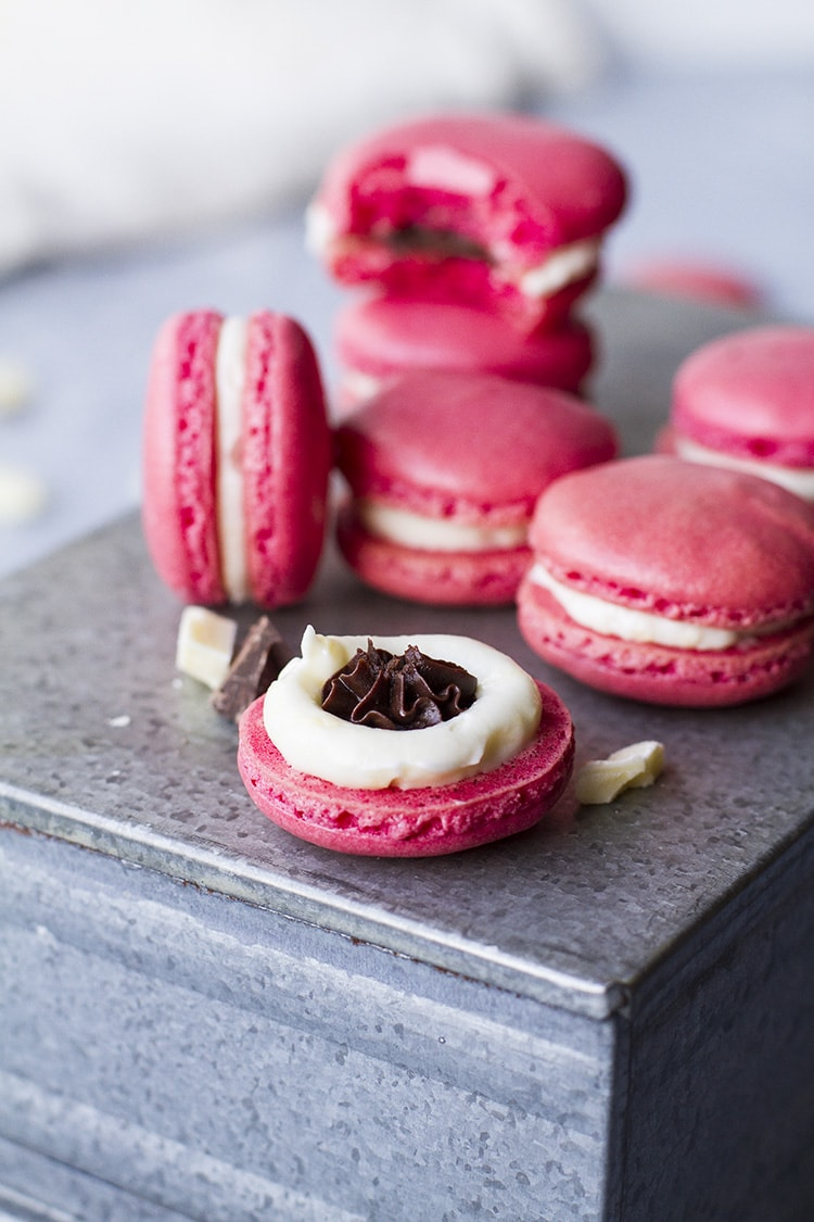 Pink macarons with white filling and mocha center.