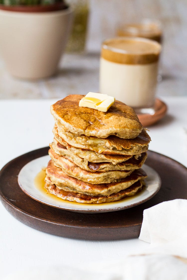 Stack of healthy banana pancakes with butter and maple syrup.