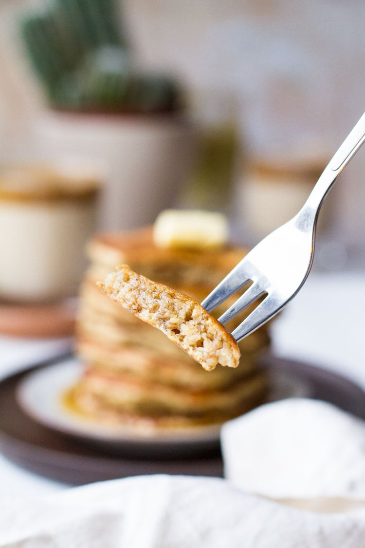 Fork with a bite of banana pancake.