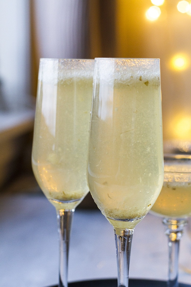 Two champagne flutes with ginger pear bellini.