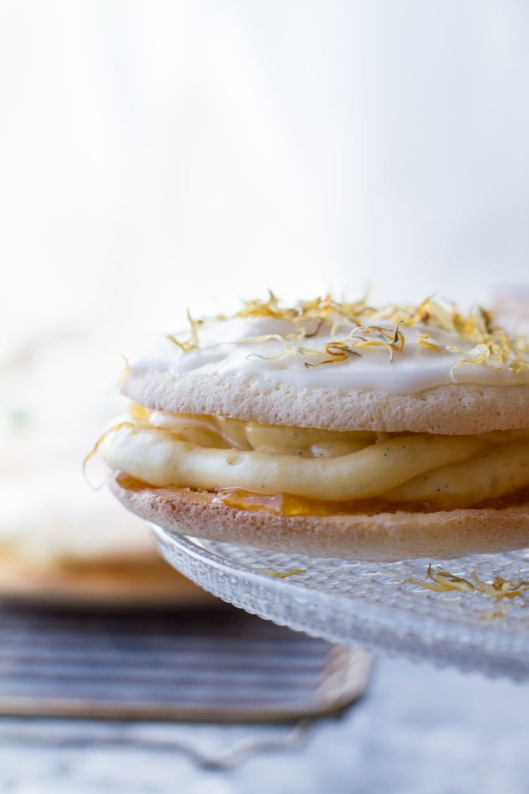 Soft cake with rum pastry cream oozing out the sides.