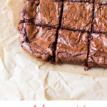9 Squares of brownies on parchment paper. Pinterest pin.