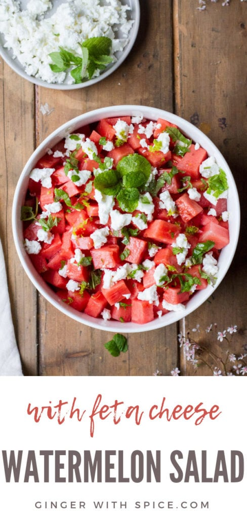 Watermelon salad in a white bowl on a wooden table, flatlay. Pinterest pin.