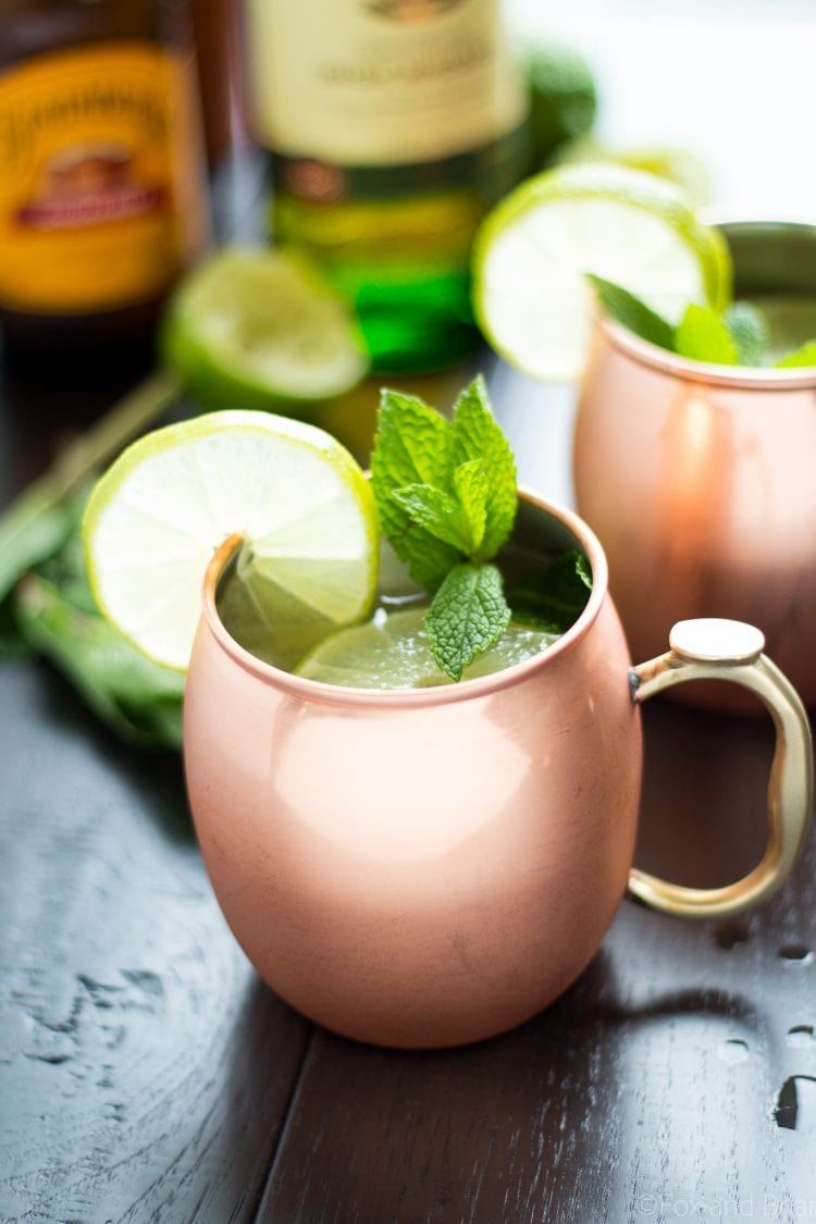Irish Mule whiskey cocktail in a copper mug with mint and lime wedge.