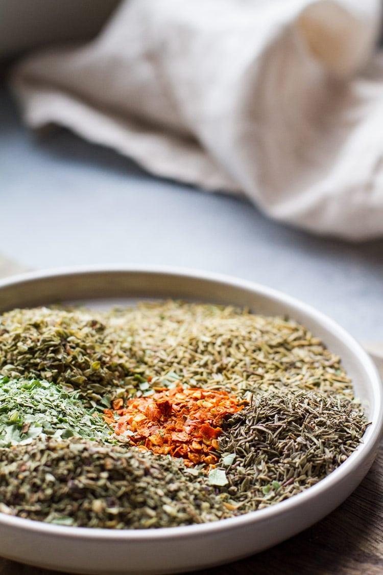 Unmixed spices in an Italian seasoning. Backlighting.
