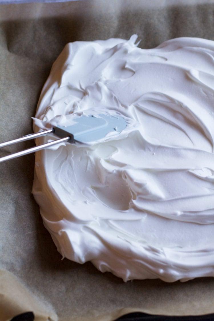 Spreading pavlova on parchment paper, for pavlova recipe