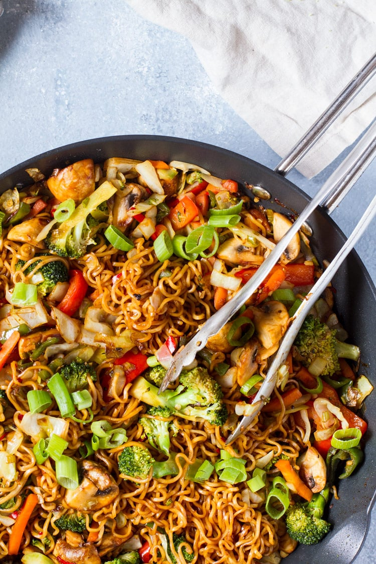 Close up of vegetarian lo mein with noodles, broccoli and mushrooms etc