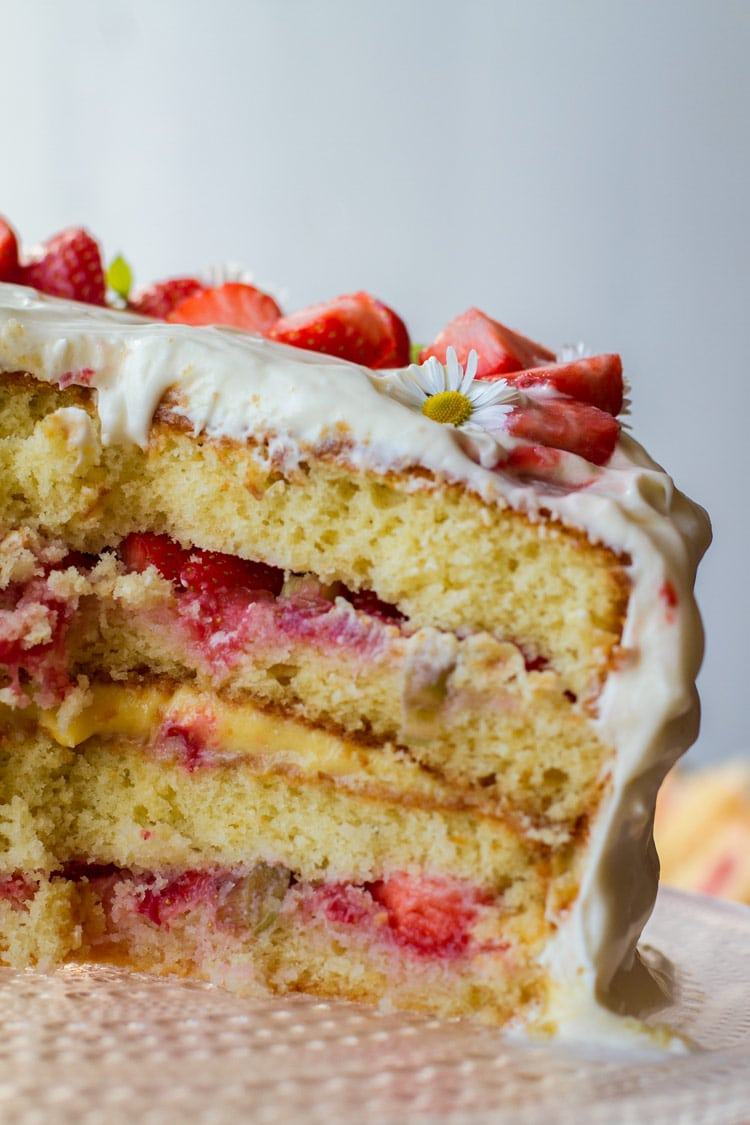 Open strawberry cake to show the layers of strawberries and lemon curd.
