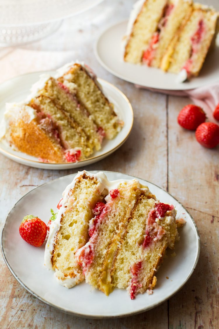 Three slices of strawberry cake with focus on one.
