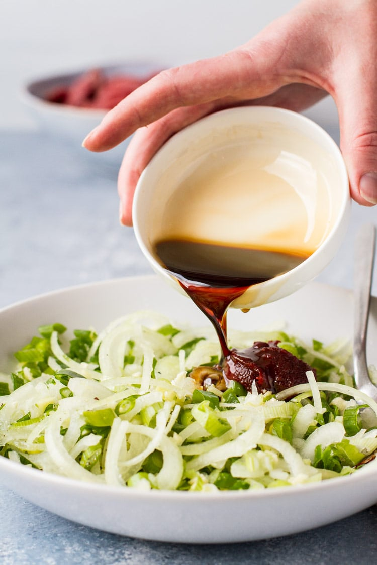 Pouring sauce into marinade ingredients.