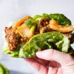 Beef bulgogi lettuce wrap with kimchi. Square photo.