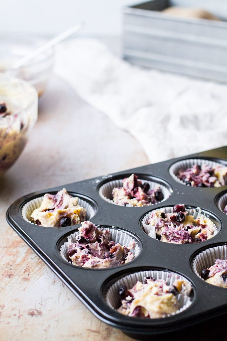 Homemade blueberry muffins batter in muffin tin.