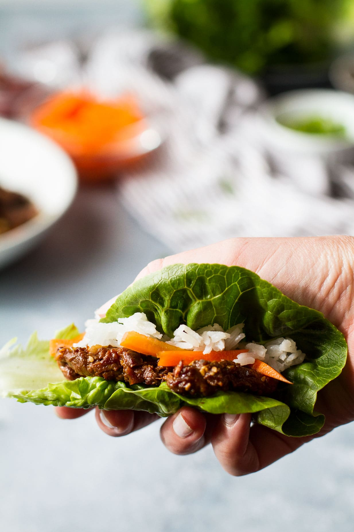 Beef bulgogi lettuce wrap with quick carrot pickle.