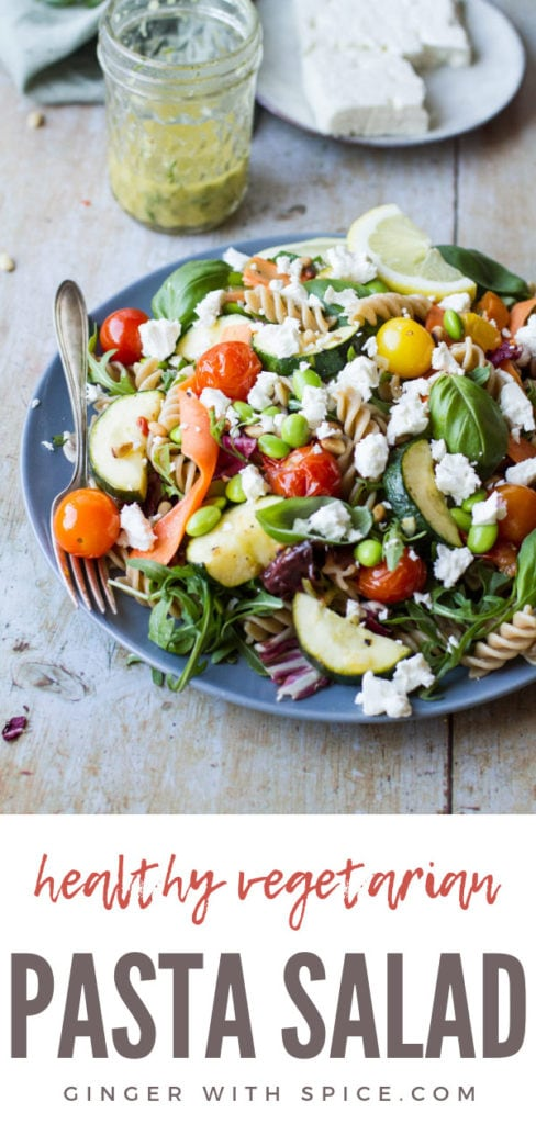 Healthy pasta salad with crumbled feta cheese, roasted tomatoes and zucchini. Pinterest pin.