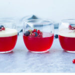 Three glasses with homemade jello, berries and two with vanilla custard. Straight on. Pinterest pin.
