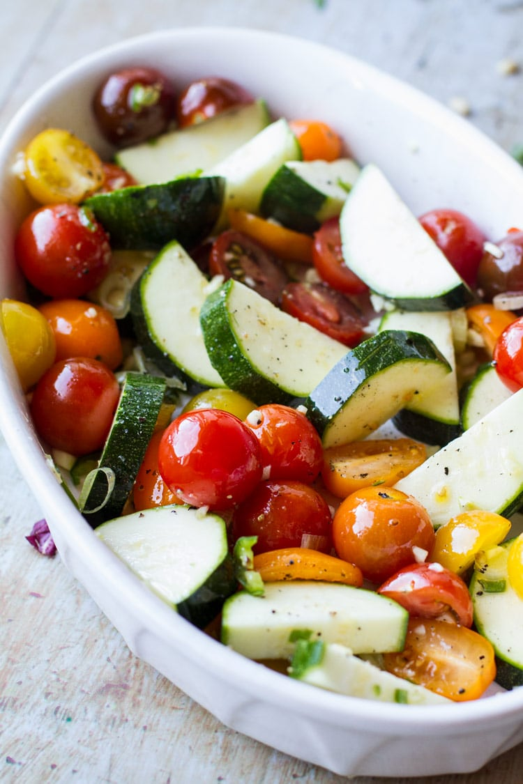 Chopped up vegetables in a white dish.
