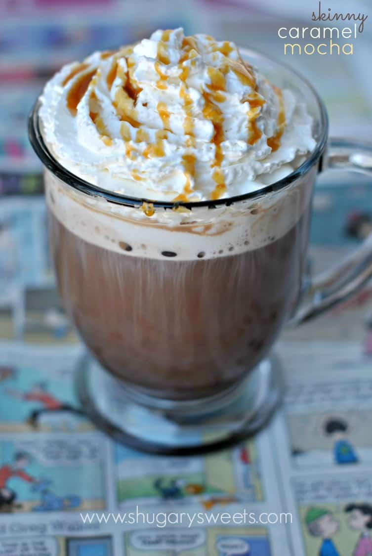 Skinny Caramel Mocha hot drink in a clear mug, whipped cream and caramel drizzle on top.