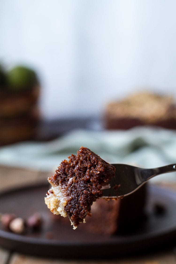 One piece of chocolate pear cake on a fork.