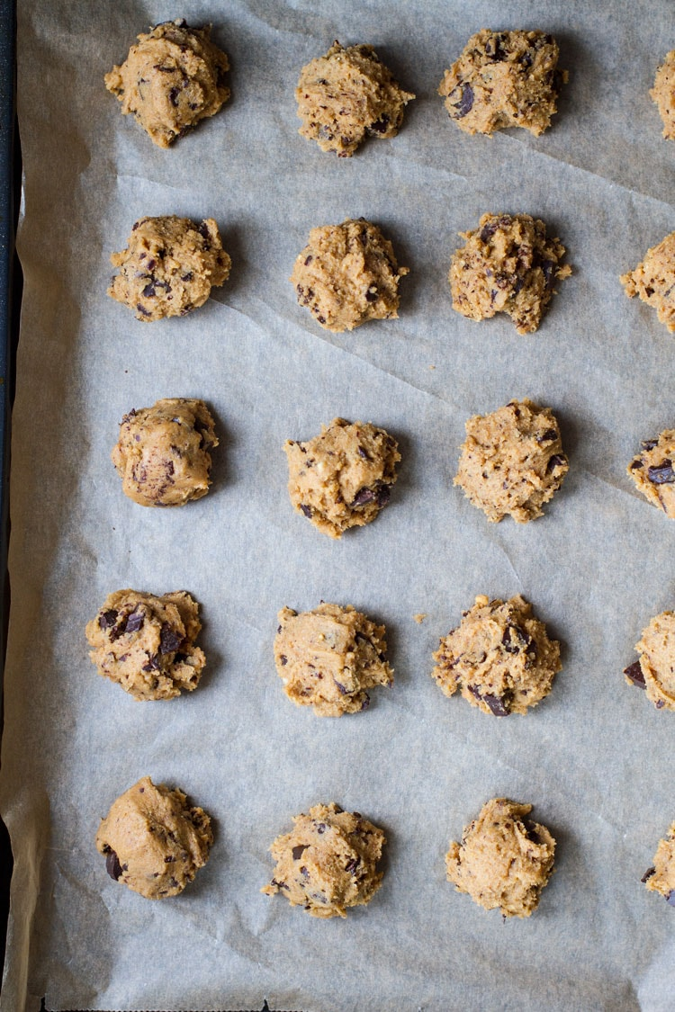Peanut Butter Chocolate Chip Cookie dough balls ready for freezing, flatlay.