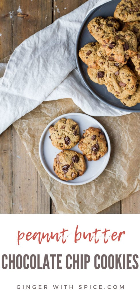 Three peanut butter chocolate chip cookies on a white plate on parchment paper and wooden table. Pinterest pin.