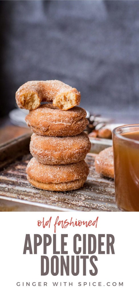 A stack of three apple cider donuts and one half on top. Pinterest pin.