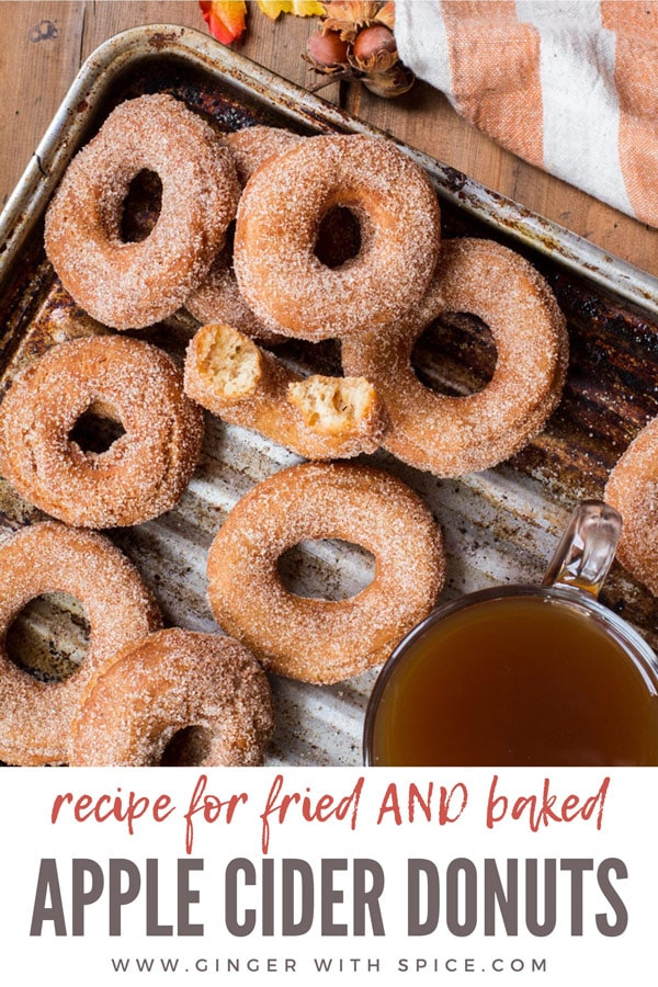 Apple cider donuts coated in sugar, on a metal pan. Pinterest pin.