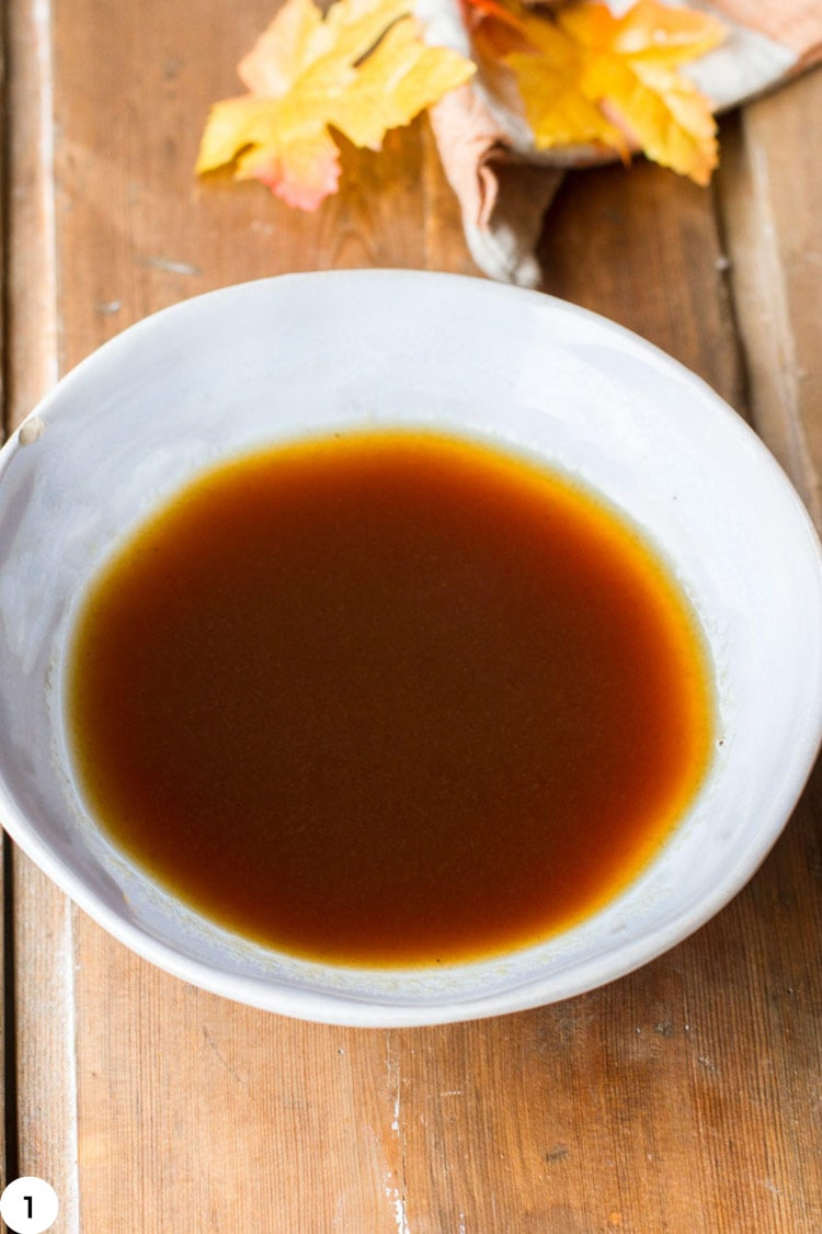 Bowl of reduced apple cider.