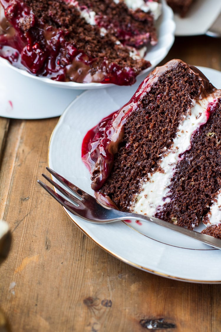 Closeup of the cakes layers of whipped cream and cherry filling.