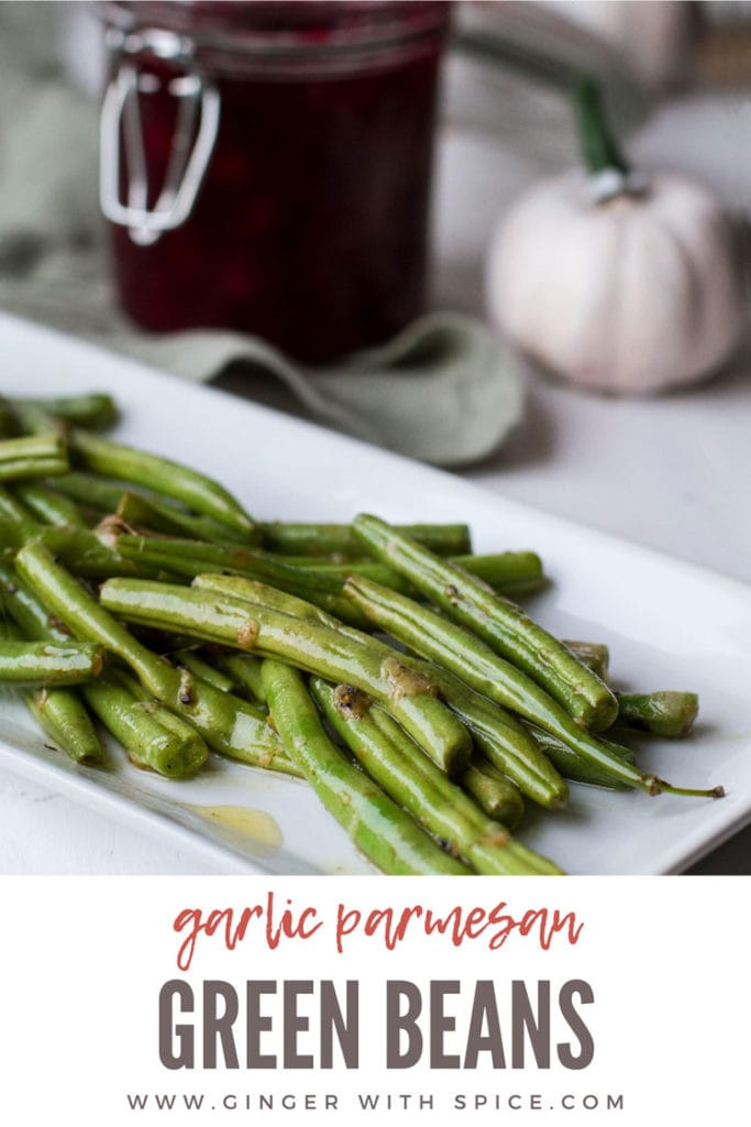 Sauteed green beans on a white, rectangular plate. Pinterest pin with text overlay.
