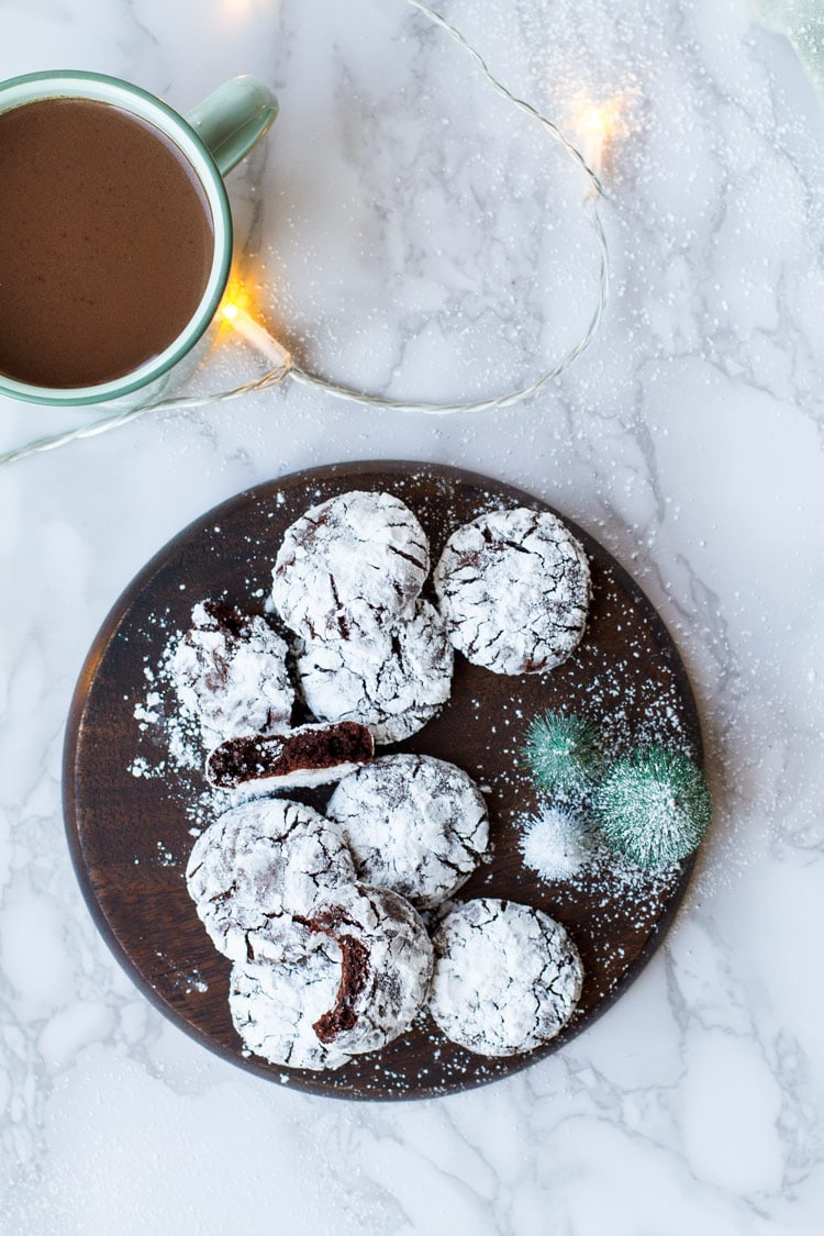 Chocolate crinkle cookies on a wooden plate, flatlay.