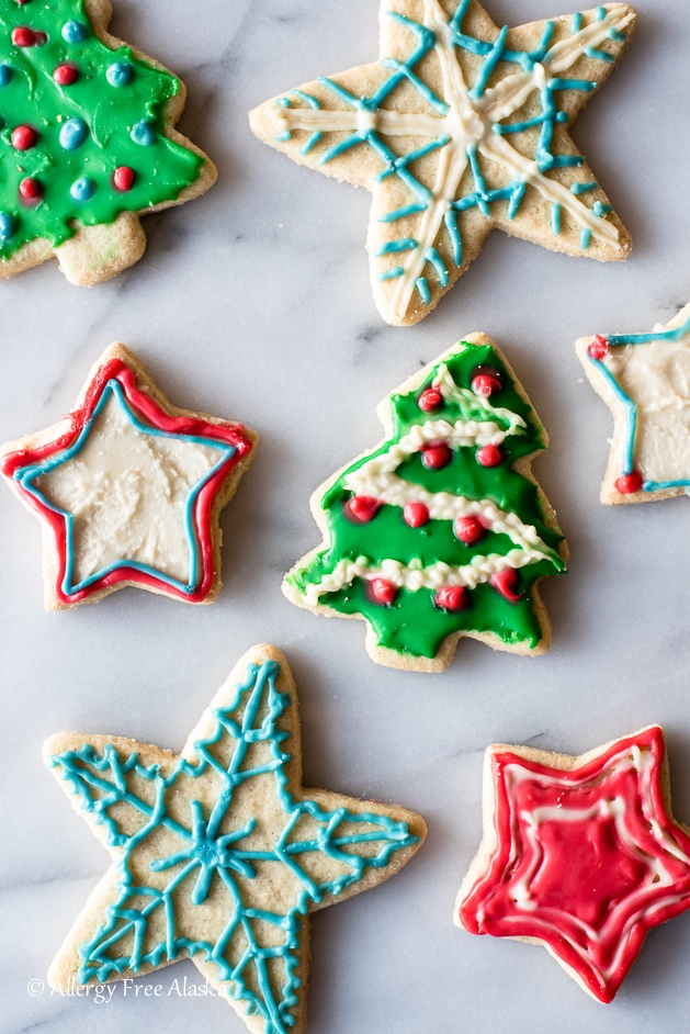 Decorated sugar cookies; Christmas trees and stars.