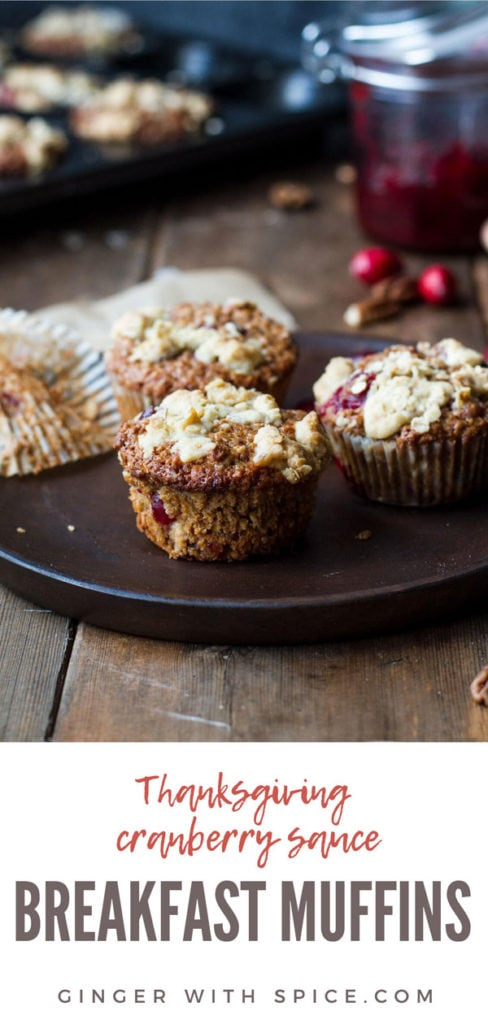Three cranberry sauce oat breakfast muffins on a wooden plate. Pinterest pin.