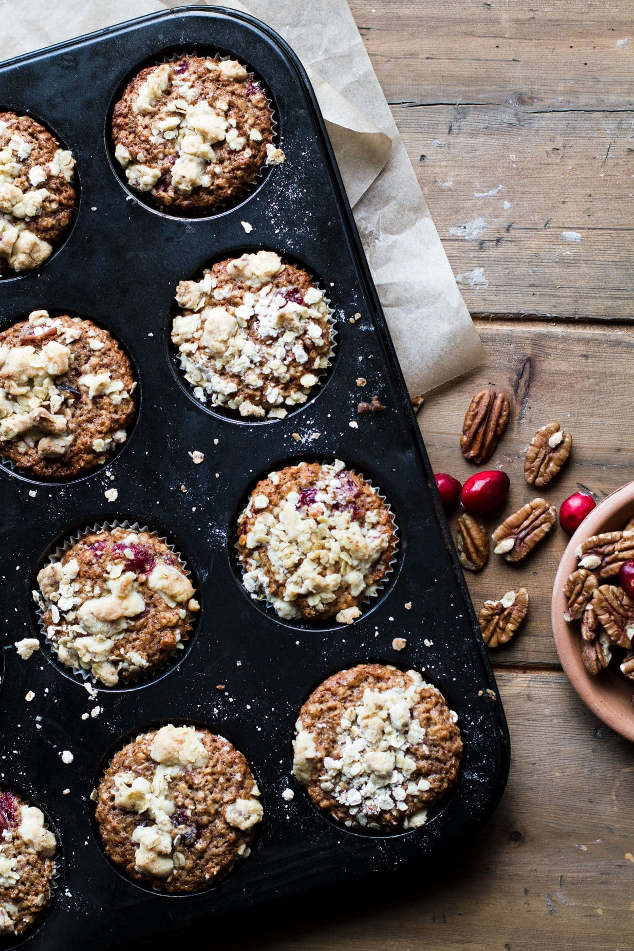 Cranberry Sauce Breakfast Muffins with crumb toppin in a muffin tin.
