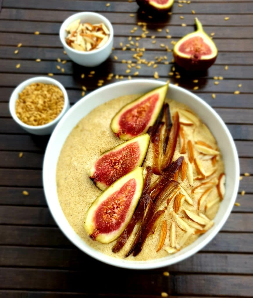 Flaxseed porridge in a white bowl, topped with fig halves.