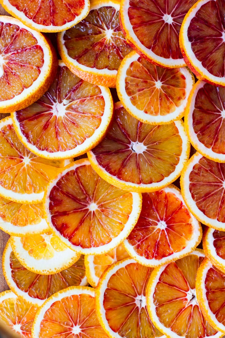 Slices of blood oranges covering the entire image.