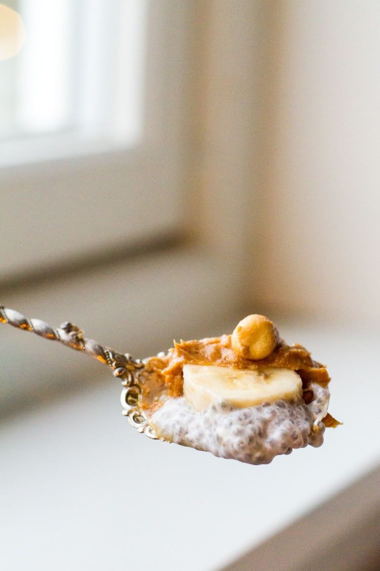 Vintage spoon with pudding, banana and peanut butter.