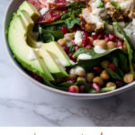Winter salad with sliced avocado and blood orange, close-up. Pinterest pin.