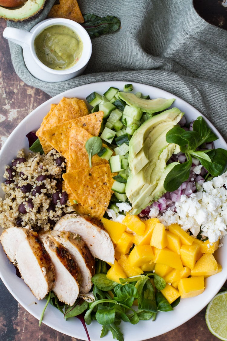 Mexican Inspired Mango Salad in a huge white bowl. Ingredients separated.