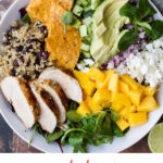 Mexican Inspired Mango Salad in a huge white bowl. Ingredients separated. Pinterest pin.