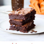 Three squares of brownies stacked on top of each other. Pinterest pin.