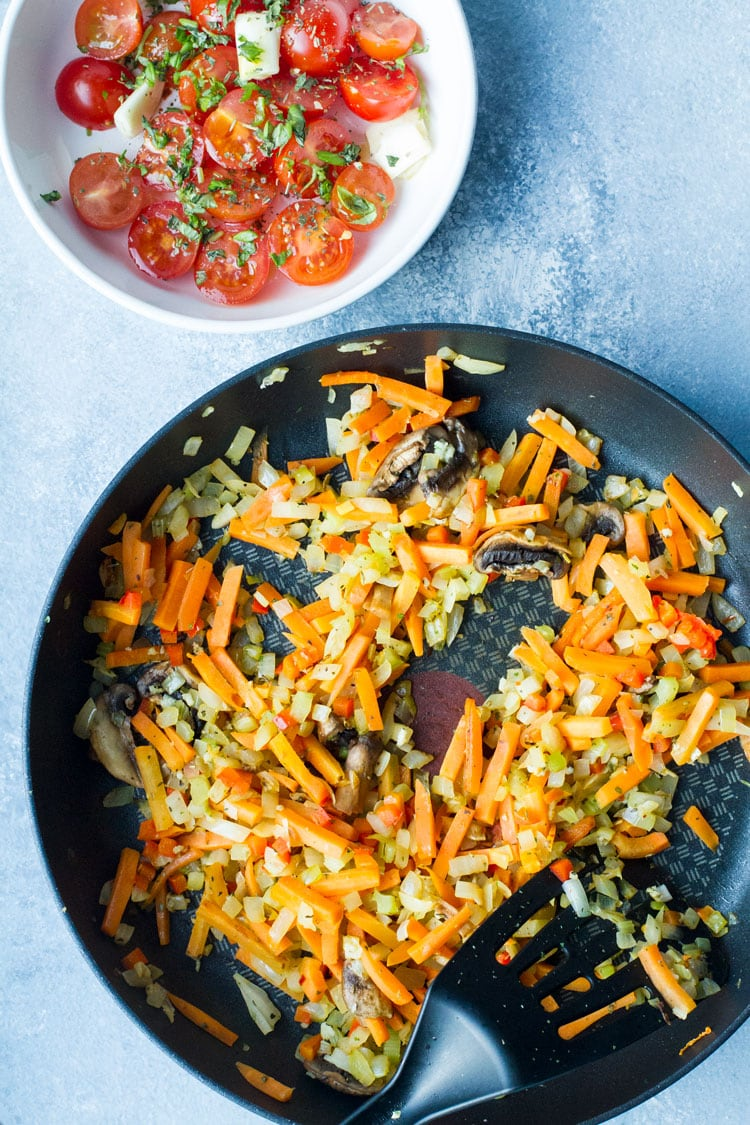 Vegetables sauteed in a saucepan, carrots, onion, celery.